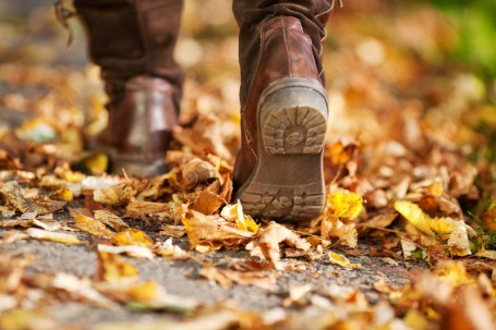 BOOTS walking thru leaves