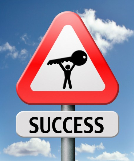 KEY TO SUCCESS road sign - clouds